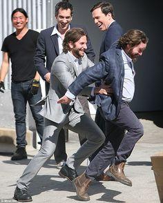 Bradley Cooper tickles Zach Galifinakis.