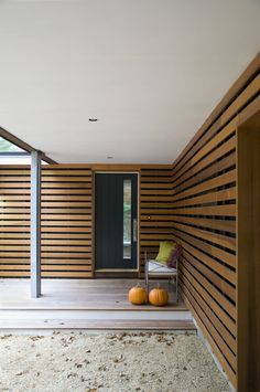 [Decoration Ideas] Astonishing Home Wall Design And Decoration Using Slatted Walls: Extraordinary Home Exterior Design Ideas Using Light Walnut Wood Slatted Wall Including Black Single Front Door And Square White Outdoor Pillar