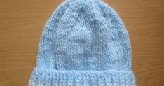 Winter Baby Hat Size: Newborn Materials: double knit yarn main and contrast colour Needles: 4mm Cast on 64 stitches Row 1: k1, ...