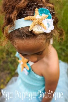 mermaid headpiece- super cute with shell, sea star and I LOVE the little piece of netting