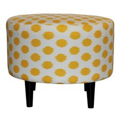 Add a pop of pattern to your living room or master suite with this charming ottoman, showcasing cotton upholstery and a polka-dot motif.        ...