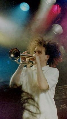 Robert Smith of The Cure love cats instruments symphony horns guitars the Cure punk big band classical training