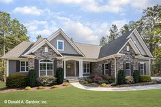 House Plans - The Satchwell - Home Plan 967 Graceful arches contrast with high gables for a stunning exterior on this Craftsman house plan. Windows with decorative transoms and several French doors flood the open floor plan with natural light.