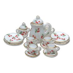 17-Pc. Cherries on the Vine Tea Set for fairy tea parties.  I cannot believe she still has all 17 pieces.