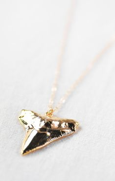 Mano Wahine - (mah NO wah-HEE-nay) - shark woman.    A gorgeous long gold shark tooth necklace. A striking shark tooth is dipped in 18kt gold and