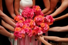 Oranges and Pinks give a nice pop against a coral bridesmaid dress.. nothing needs to be too matchy matchy ..