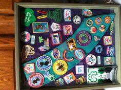 Girl Scout badges shadow box. Need to do this with my sash and badges that are just sitting in a box.