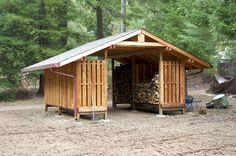 Wood storage never looked so good! Designed by my husband this shed stores lots of firewood. There are two matching sections on the other side too. We can drive our Kawasaki Mule right in to load up. We looked at lots of storage ideas for firewood befor Wood Storage Sheds, Storage Shed Plans, Storage Ideas, Storage Design, Small Storage, Firewood Shed, Firewood Storage, Log Shed, Barns Sheds