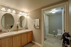 Round mirrors really update this double vanity in the master bathroom.