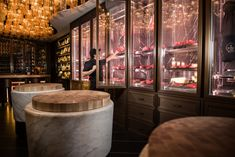 The Beefbar is a luxury butcher shop in Monaco, accented with white-marble chopping blocks designed by Humbert & Poyet.