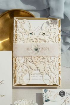 The elegant greenery pattern is a gorgeous addition to this invitation. The Translucent Vellum Belly Band and gold backing features this simple patter and the Laser Cut Wrap unfolds beautifully