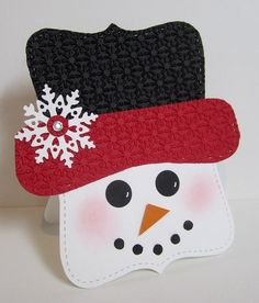 handcrafted Christmas card .... shaped like a snowman head ... paper piecing punch art ... Top Note base ... poinsettia all over embossed hat ... die cut snowflake ... sweet face with blushing cheeks ... great card!!! ,,, Stampin' Up!