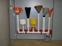 "Great way to store funnels (and empty ""empty"" oil cans)"