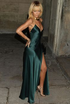 Slinky: Rihanna dazzled at the Stella McCartney Winter 2012 London Evening Wear Presentation on Saturday night in Mayfair in a daring evening gown    3      1