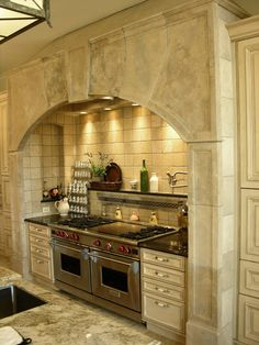 Wow very dramatic yet practical use of space with these amazing stove top ranges and ovens plus the eye catching arch way with loads of space for all ur spices and then some Custom Kitchens, Home Kitchens, Cool Kitchens, Rustic Kitchen, Kitchen Remodel, Kitchen Design, Kitchen Inspirations, Kitchen Range Hood, Stone Architecture