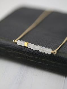 Minimalist Gold Moonstone Necklace / Jewelry by burnish / Natural White Gemstone Bar Necklace with 14K Gold Filled Chain by burnish on Etsy https://www.etsy.com/listing/224688812/minimalist-gold-moonstone-necklace