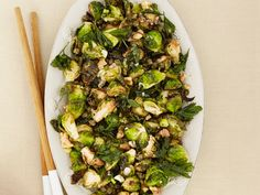 Fried Brussels Sprouts with Walnuts and Capers Recipe : Michael Symon : Food Network