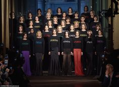 Big finale:The models later posed on the runway side by side for the finale as they lapped up the rapturous applause