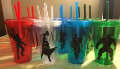 Dollar Store tumblers & Avengers silhouettes cut on vinyl with my Cricut and I made the perfect party favors for my son's 4th birthday