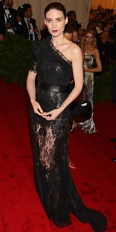 ROONEY MARA    Stepping out in a stark Givenchy Haute Couture by Riccardo Tisci style, Rooney softens her typically hard look with layers of lace, a sheer skirt and rosy lips.