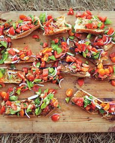 Heirloom Tomato Bruschetta | Martha Stewart Living - Rub toasted baguettes with garlic and crown with a variety of heirloom tomatoes, thinly sliced red onions, and basil leaves for a crowd-pleasing summer appetizer.