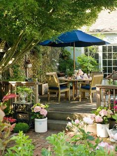 A bold blue umbrella provides style and shade for this relaxing patio