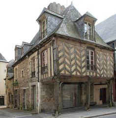 Medieval house in Vitré (Bretagne) France. This house has exposed timber frames in the herringbone pattern. The herringbone pattern was first used around 200 BC but thought to be older.