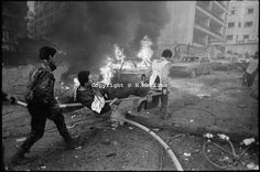 Beirut, Lebanon february 29th 1984. A injured man on a strecher is evacuated from the scene of a car bomb explosion by rescuers.©Herve Merliac