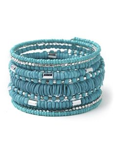 Layer this fresh coil bracelet over your wrist for an instant pop of style. Multi-sized beads and thin, shell accents add unique detail. Customized in size and scale for the plus size woman. For your comfort, all Catherines jewelry is free of lead and nickel. catherines.com