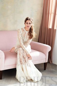 Olivia Palermo Brides cover shoot - Lace fit and flare wedding dress with ruffle skirt; Elie Saab, Stud earrings; Alexandra Mor, Linear fish earring; H Stern