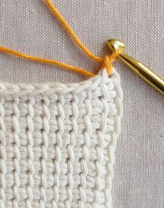 I worked in our store for years before I finally learned the story of the weirdly long crochet hooks that kept getting tucked away in a forgotten corner. Oh, those? They're just the tool you need to whip up one of needlework's most beautiful fabrics!  Tunisian Crochet may get overlooked in the corner sometimes, but the distinctiveness of its fabric warrants closer scrutiny. It combines a waffle-like grid with a squishy density that is just right for blankets, pillows, dishtowels, and these…