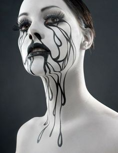 Be spooky yet classy this Halloween with this makeup inspiration. Using black and white makeup, draw intricate lines interconnecting on your face and neck to create a wonderful illusion of overflowing black tears.