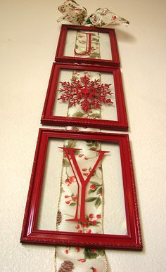 I have this exact ribbon. Love this idea for the doors in the kitchen! Cute Christmas JOY using Dollar Store frames
