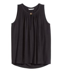 Wide-cut sleeveless top in soft, gently draping jersey with a sheen. V-neck with metal clasp at top and pleats at neckline.