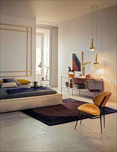 Bruno Tarsia interior featured in Marie Claire Maison: Brass pendant lights by Vilhelm Lauritzen for Louis Poulsen, ca.1960s.