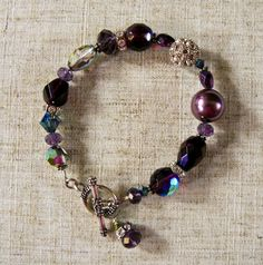 Vineyard Plum Bracelet with Pearl, Crystal, and Prism Glass  Materials: Pearl, Crystal, Rhinestone, Prism Glass, Sterling Silver Toggle