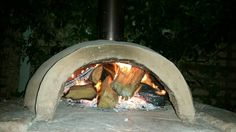 Newly installed Vibraneat Precast Pizza oven being fired up by proud owner