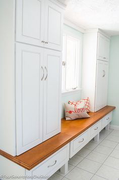 Gorgeous mudroom makeover. You have to see the before of this space. A blank wall was transformed to a functional and stylish locker unit to store coats, hats, bags ect. See the before and after. It's drastic.