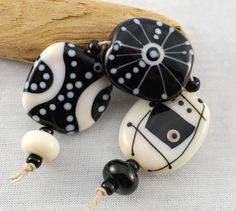 BLACK and CREAM set of 5 mixed shape glass beads by jperaladesigns, $22.00