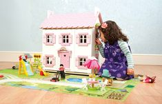 A delightfully pink dolls house which will be a great home for your Budkins characters or any other figures up to 1 tall. The house has three floors and includes a staircase and removable roof panels and flower boxes. Hand painted and decorated with attra