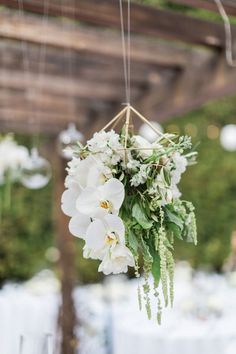 Suspended Floral Geo Shapes As Wedding Decor ~ close-up of the all white blooms and greens