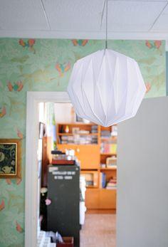 Origami lamp, how to on: http://serjbumatay.blogspot.dk/2011/04/how-to-make-origami-paper-lantern.html
