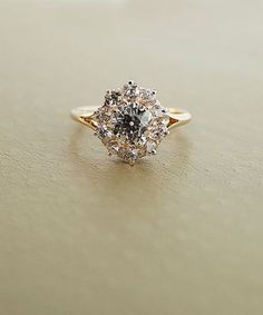 Beautiful vintage diamond engagement ring with halo and gold band.