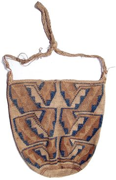 Chancay, Peru, c. 1100 - 1450 AD. Coca bag with geometric pattern in deep blue and beige over a creme ground and a rope handle. via (oldlawrence)