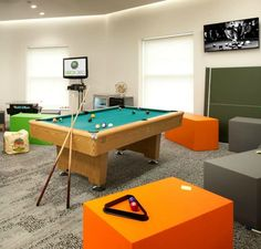 This games room at eBay is the perfect fun space for workers to relax. With a pool table, flat screen TV, xBox and a variety of seating spaces workers can kick back and relax when they are not working. Bright colours including orange and green help to create a vibrant feel to this fun break-out space. See more of this office design for eBay by clicking the image.
