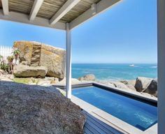 This holiday accommodation is a pristine, two bedroom luxury beach cottage in the private Bakoven community. Rent A Villa, V&a Waterfront, Holiday Accommodation, African Safari, Beach Cottages, Luxurious Bedrooms, Luxury Villa, Cape Town, The Rock