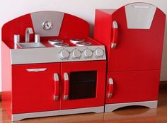 - Hip Kids has a fine selection of wooden retro pretend play kitchen sets. This particular red pretend play toy kitchen set is ideal for toddlers and older kids. Funky in design and beautifully crafted, these play