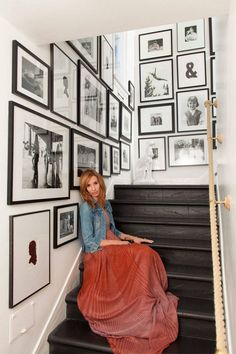 black and white art gallery + dark wood staircase + nautical rope banister