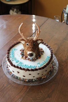 Deer hunter cake. Head sculpted with rice crispy treat recipe with fondant antlers