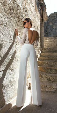 Eva Lendel Wedding Dresses 2018 Collection ❤ moderm bridal jumpsuit with open … Eva Lendel Wedding Dresses Collection 2018 ❤ Fashionable Bridal Jumpsuit with Open Back and Long Sleeves Trend 2018 Eva Lendel Kody ❤ See more: www. Mode Outfits, Fashion Outfits, Fashion Trends, Wedding Jumpsuit, Wedding Pants, White Pantsuit Wedding, Wedding Dress Suit, Wedding Dresses 2018, Elegant Outfit